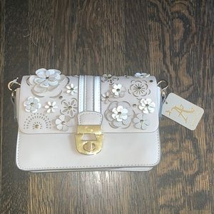 Accessorize purse with flower pattern